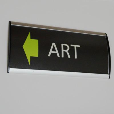Curved aluminium wayfinding signs