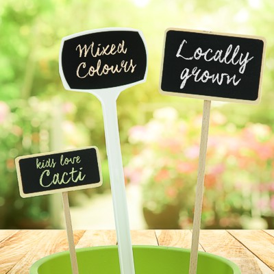 Ground stake sign holders and plant labels with write-on heads
